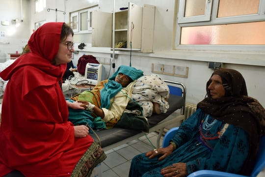 Dr Severine Caluwaerts talking with a patient in Khost maternity hospital.