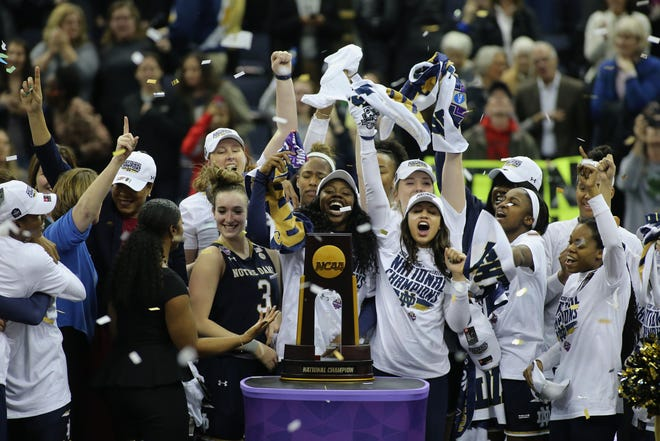 Notre Dame players celebrate after defeating Mississippi State in the national championship game of the 2018 NCAA women's basketball tournament.