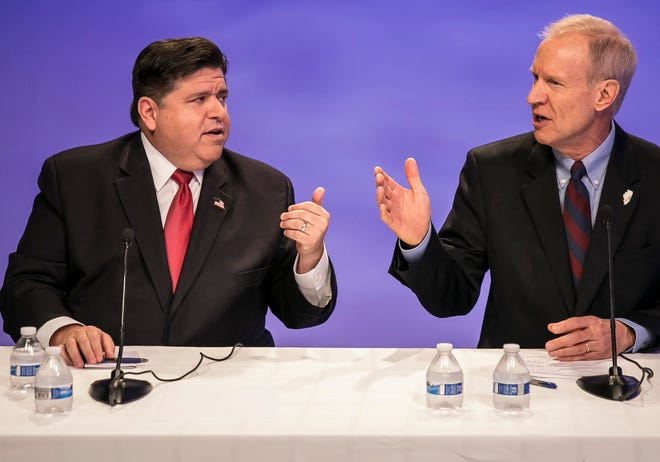 Illinois Republican Gov. Bruce Rauner, right, and Democratic challenger J.B. Pritzker face-off in a debate in Chicago on Oct. 9, 2018. Raunder is seeking a second term.