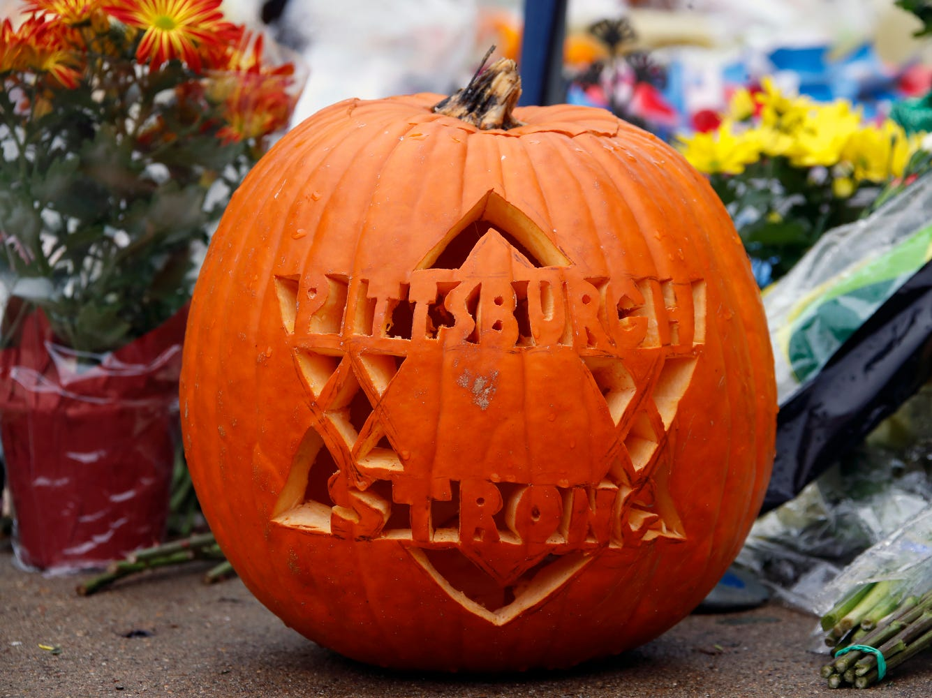 This pumpkin reflects community sentiment, Thursday, Nov. 1, 2018, at a makeshift memorial outside the Tree of Life Synagogue.