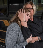 Jennifer Rigdon, left, and her mother Pam Isbell share memories of her grandmother Barbara Scott at Lebanon Baptist Church in Pendleton on Friday.  Husband and wife Michael and Cathy Scott, 59 and 60, and their mothers, 80-year-old Barbara Scott and 82-year-old Violet Taylor were killed in the Refuge Road home in Pendleton in November 2015, an unsolved case the family hopes will get solved.