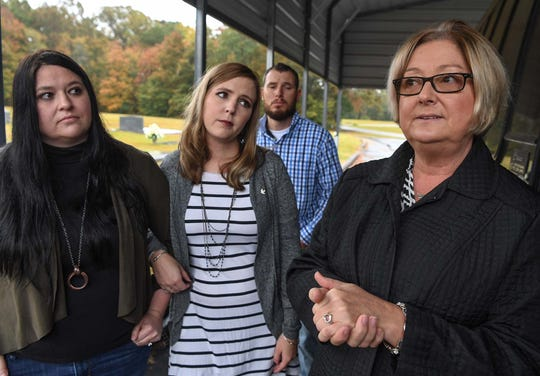 Tammy White, left, Jennifer Rigdon and husband Shafford Rigdon, and Pam Isbell, right, talk at Lebanon Baptist Church in Pendleton on Friday.  Husband and wife Michael and Cathy Scott, 59 and 60, and their mothers, 80-year-old Barbara Scott and 82-year-old Violet Taylor were killed in the Refuge Road home in Pendleton in November 2015, an unsolved case the family hopes will get solved.