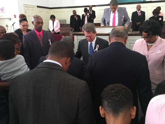 Democratic gubernatorial candidate Rep. James Smith, center in blue tie, prays at Rocky Creek Missionary Baptist Church
