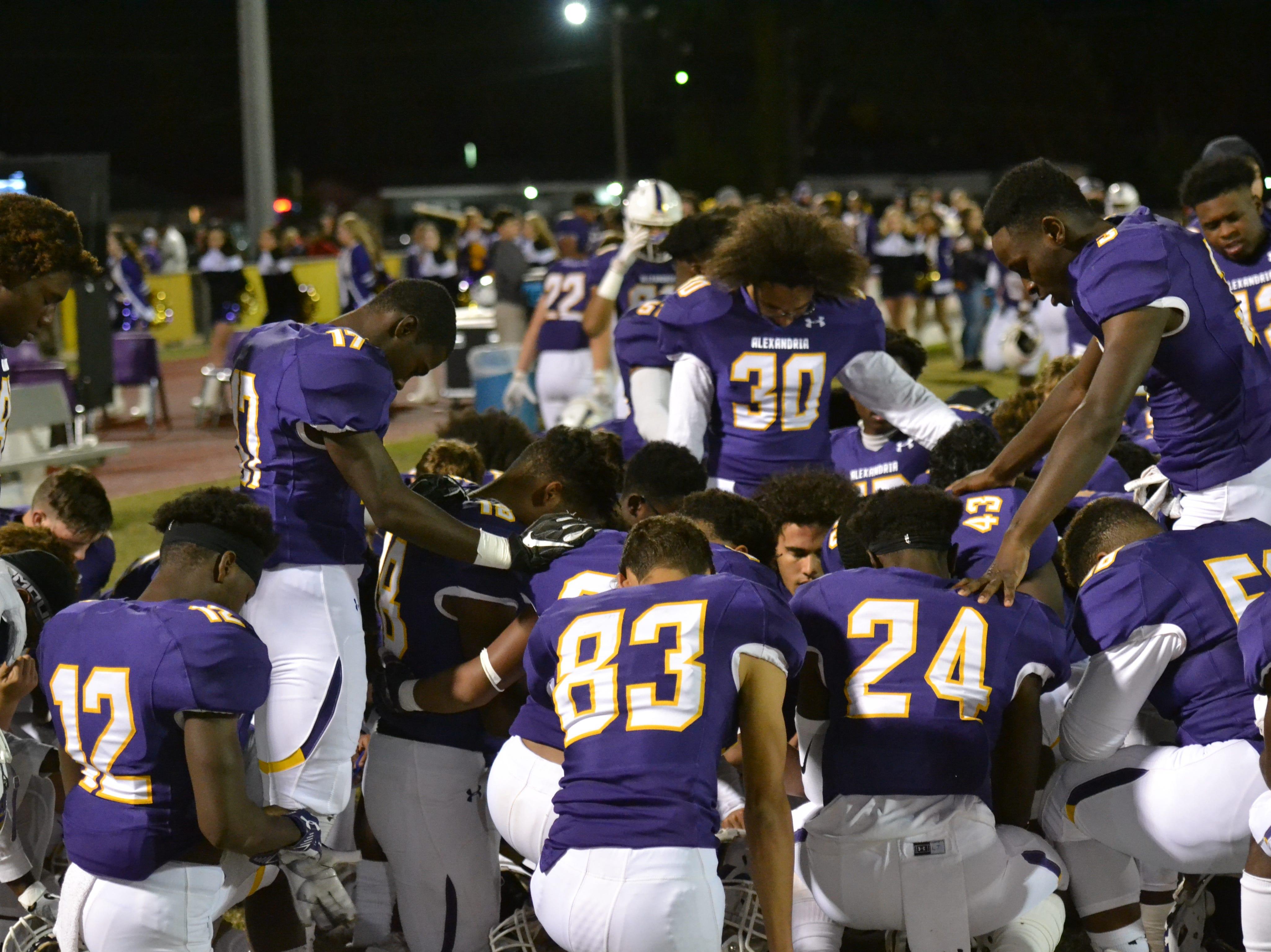 ASH players gather in prayer before the game. The ASH Trojans fell to the Ouachita Parish Lions 42-20 Thursday, Nov. 1, at Alexandria Senior High.