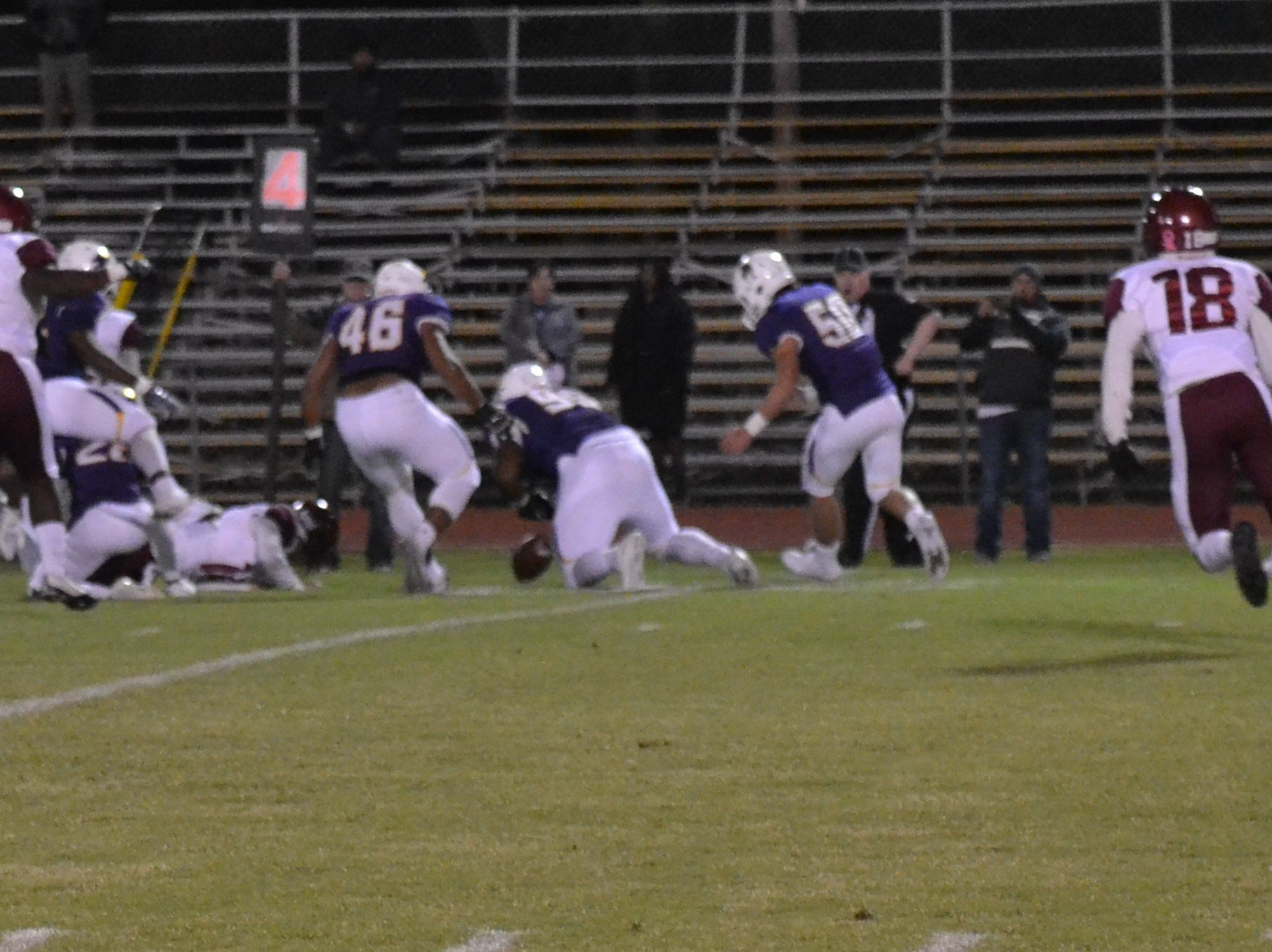 ASH's Jacobian Guillory (99) is there to pounce on the loose ball and recover for the Trojans. The ASH Trojans fell to the Ouachita Parish Lions 42-20 Thursday, Nov. 1, at Alexandria Senior High.