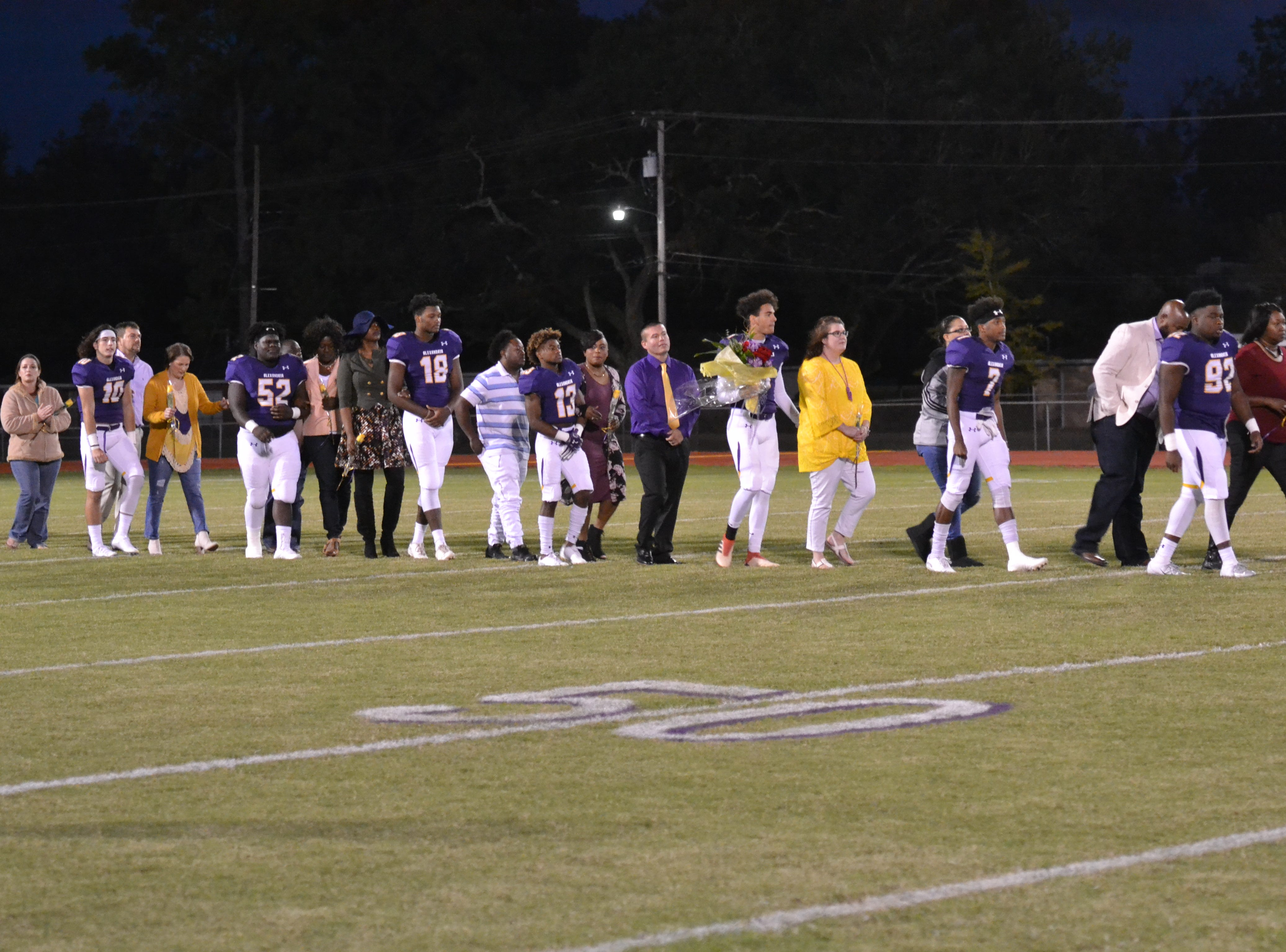 ASH senior football players were honored  before the start of the game. The ASH Trojans fell to the Ouachita Parish Lions 42-20 Thursday, Nov. 1, at Alexandria Senior High.