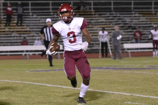 Ouachita wide receiver C.J. Brown picks up yards for the Lions. The ASH Trojans fell to the Ouachita Parish Lions 42-20 Thursday, Nov. 1, at Alexandria Senior High.