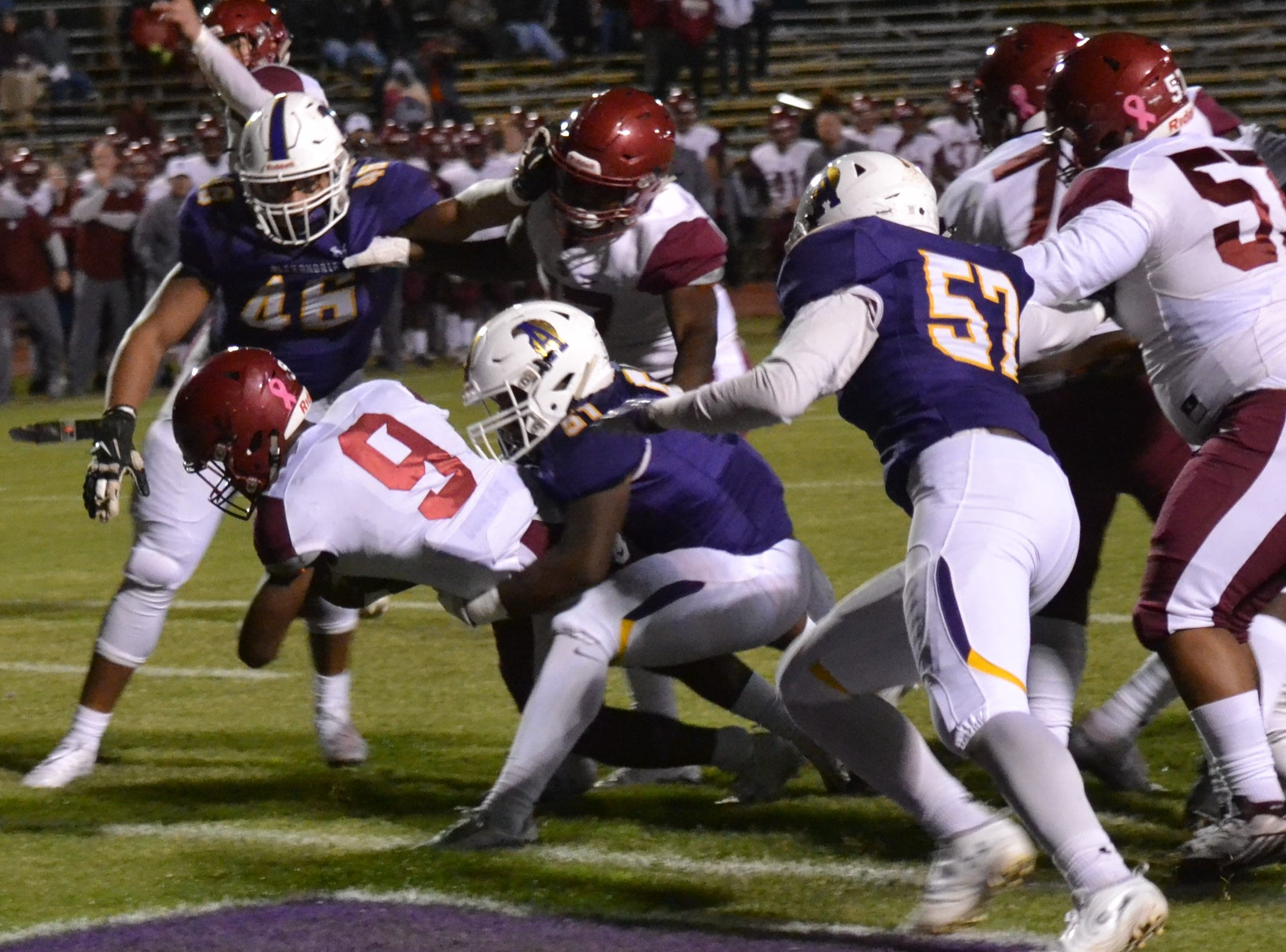 Ouachita Lion running back Dylan Roberts stretches for the goal line and scores the game's first touchdown. The ASH Trojans fell to the Ouachita Parish Lions 42-20 Thursday, Nov. 1, at Alexandria Senior High.