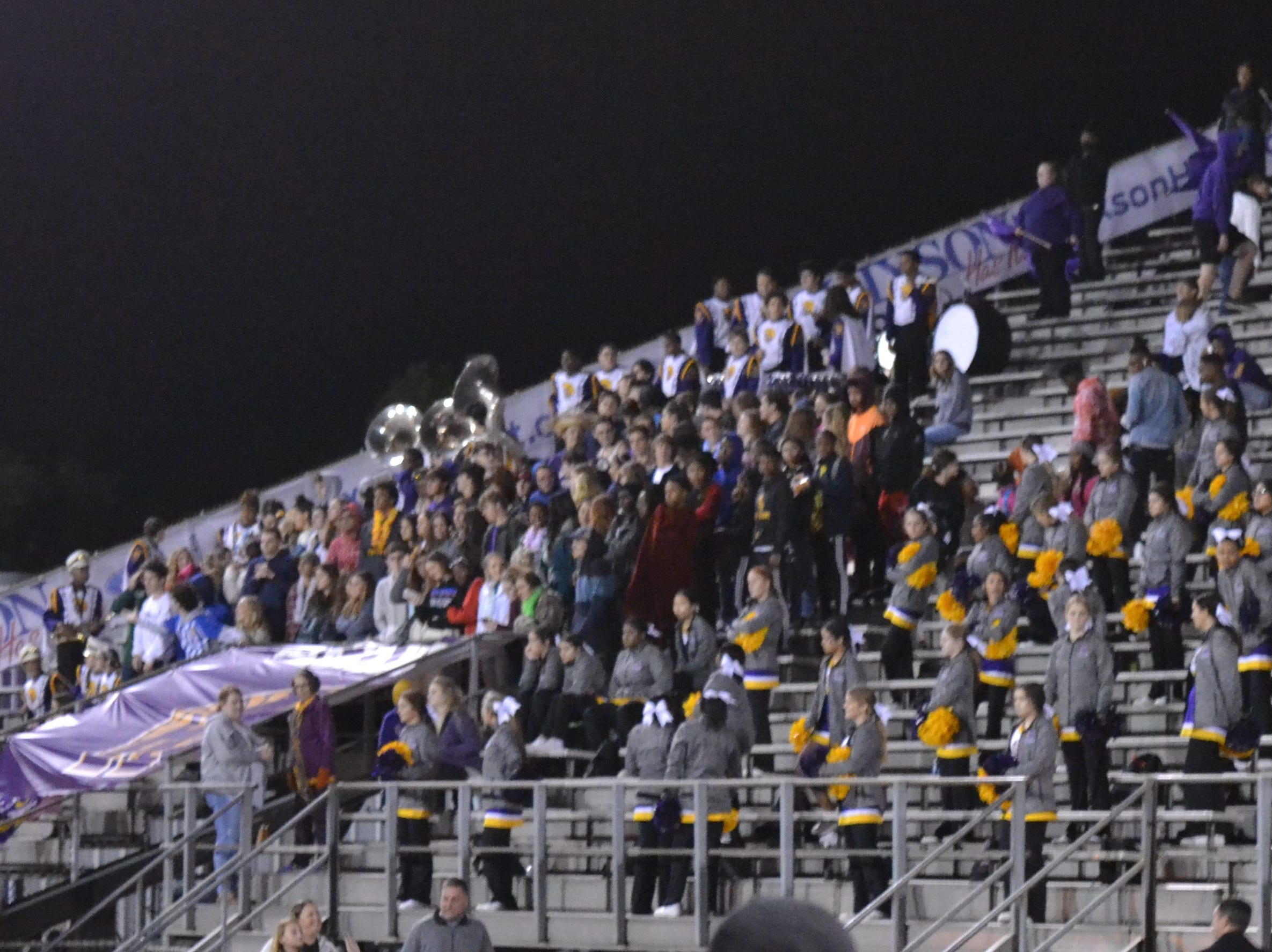 ASH students and band members cheer on the Trojans on a chilly night at Butch Stoker Stadium. The ASH Trojans fell to the Ouachita Parish Lions 42-20 Thursday, Nov. 1, at Alexandria Senior High.