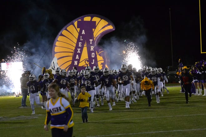 ASH football players take the field before a 2018 game against Ouachita.