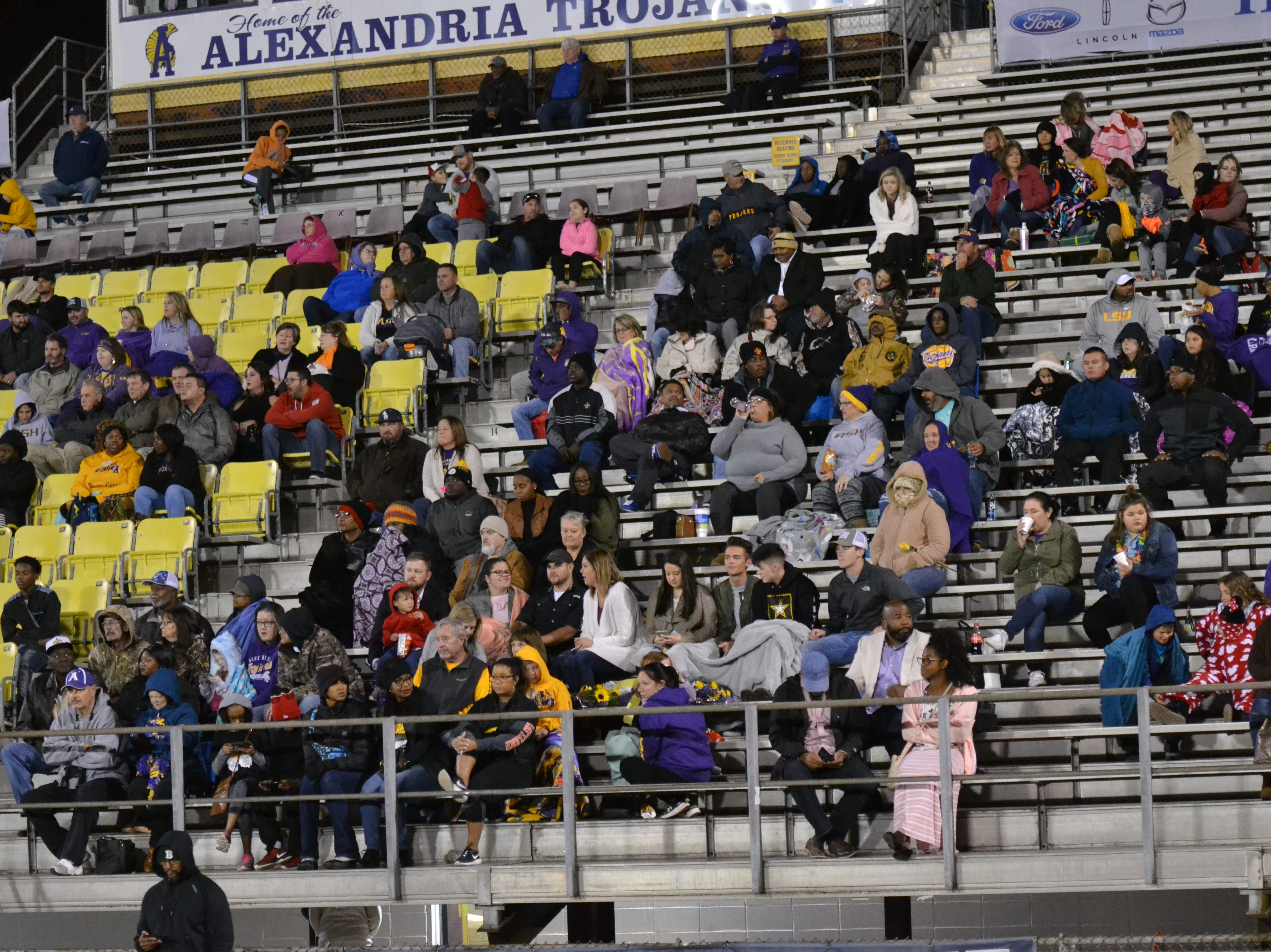 ASH fans try to stay warm on a chilly night. The ASH Trojans fell to the Ouachita Parish Lions 42-20 Thursday, Nov. 1, at Alexandria Senior High.