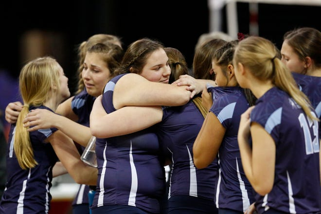 Little Chute players console each other after losing to Kettle Moraine Lutheran during a Division 2 state semifinal volleyball match Friday at the Resch Center in Ashwaubenon.