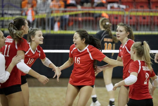 Kimberly's Ruby Esser celebrates winning a tough point against Burlington in the WIAA Division 1 state volleyball tournament Thursday at the Resch Center in Ashwaubenon.
