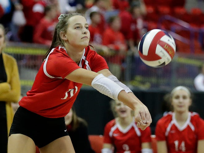 Kimberly's Courtney Pearson digs a spike against Burlington during the WIAA Girls State Volleyball Tournament on Thursday at the Resch Center in Ashwaubenon.