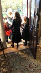 Orthodox family in Toms River welcomes trick or treaters.