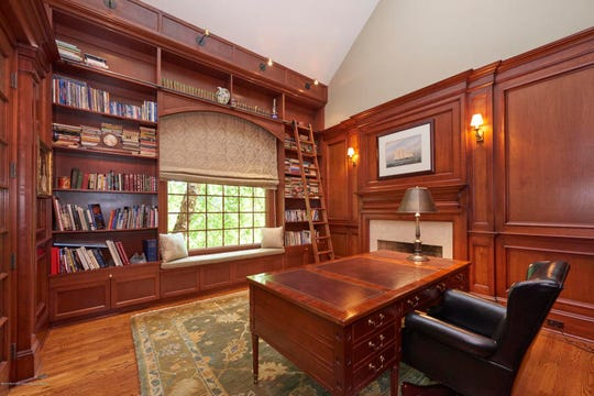 The home offers a personal library with custom built-ins.