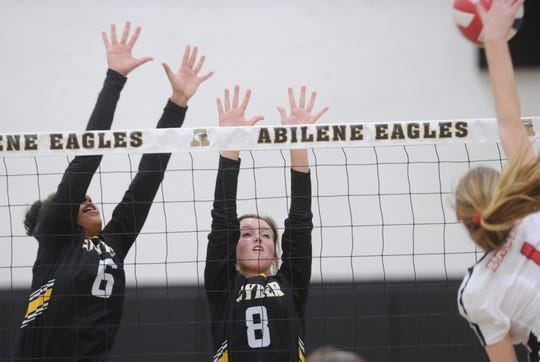 Snyder's Kate McWilliams (8) and Kamiah Davis (6) defend at the net as Argyle's Paxton McGlinch hits the ball. Argyle won the Region I-4A second-round match 25-21, 25-8, 25-14 on Thursday, Nov. 1, 2018, at Abilene High's Eagle Gym.