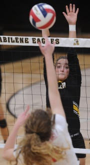 Snyder's Natalee James defends at the net as an Argyle player hits the ball. Argyle won the Region I-4A second-round playoff match 25-21, 25-8, 25-14 on Thursday, Nov. 1, 2018, at Abilene High's Eagle Gym.