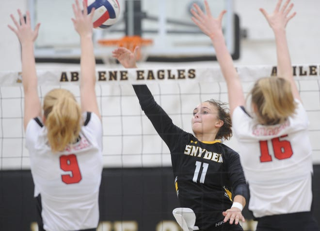 Snyder's Natalee James (11) hits the ball between Arygle defenders Kiley Lavelle (9) and Jessie Moore (16). Argyle won the Region I-4A second-round playoff match 25-21, 25-8, 25-14 on Thursday, Nov. 1, 2018, at Abilene High's Eagle Gym.