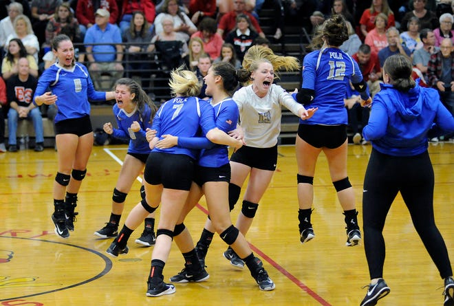 Polk County celebrates after winning the 1A West region