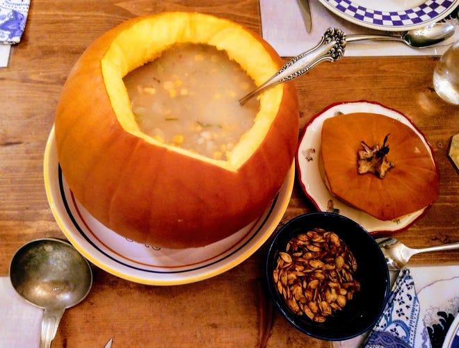 Corn, bean and squash chowder in a pumpkin.