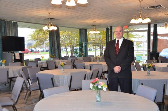 Chris Pant, funeral director at Baxter Funeral & Cremation Service, stands in the onsite banquet facility that is one of the more popular options for families looking for nontraditional memorial events.