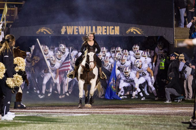 The Western Michigan football team takes the field at Waldo Stadium in Kalamazoo on Thursday, November 1, 2018.