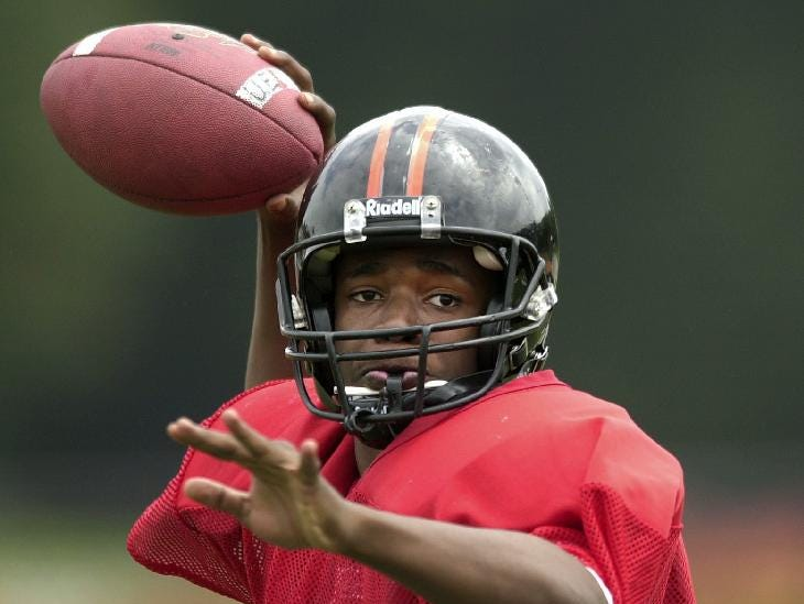 From 2004: Union-Endicott Quarterback Jermaine Thomas looks for a receiver during practice.