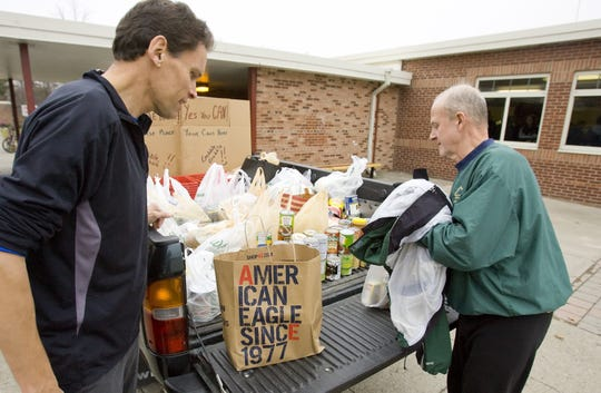 From 2010: Turkey Trot organizer Bruce Roebal watches Thursday morning as the truck fills up with food donated by runners. The food will be delivered Friday to Loaves and Fishes.