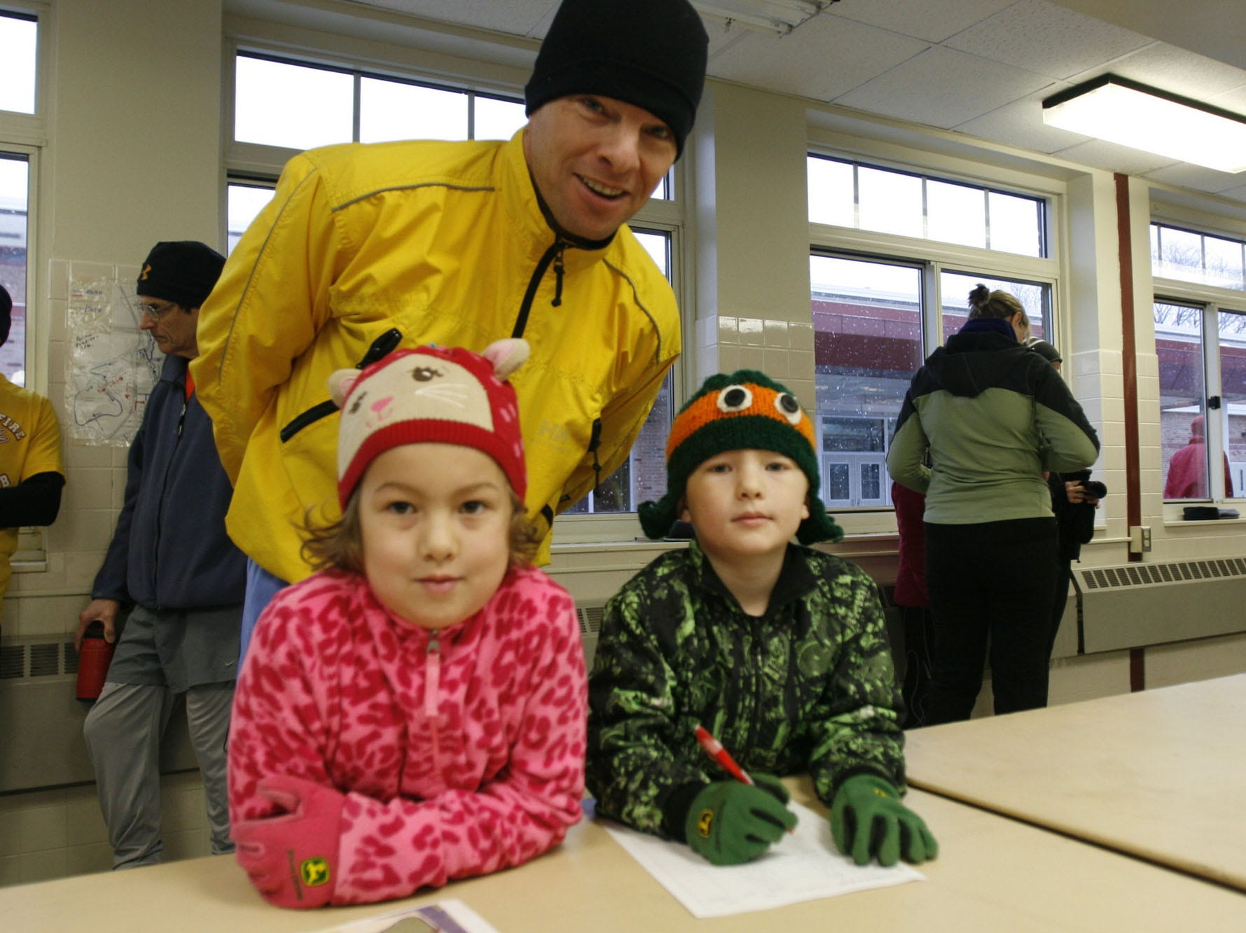From 2014: From left, Elisabeth Young, 7, Steven Young and Jacob Young, 6, register for the Ithaca Turkey Trot.