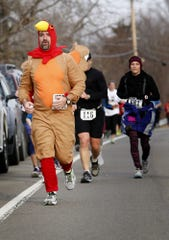 From 2015: Steven Brown, of Arlington, Washington, rounds the last turn to complete the Turkey Trot Thursday morning. Runners began and finished at Notre Dame High School.