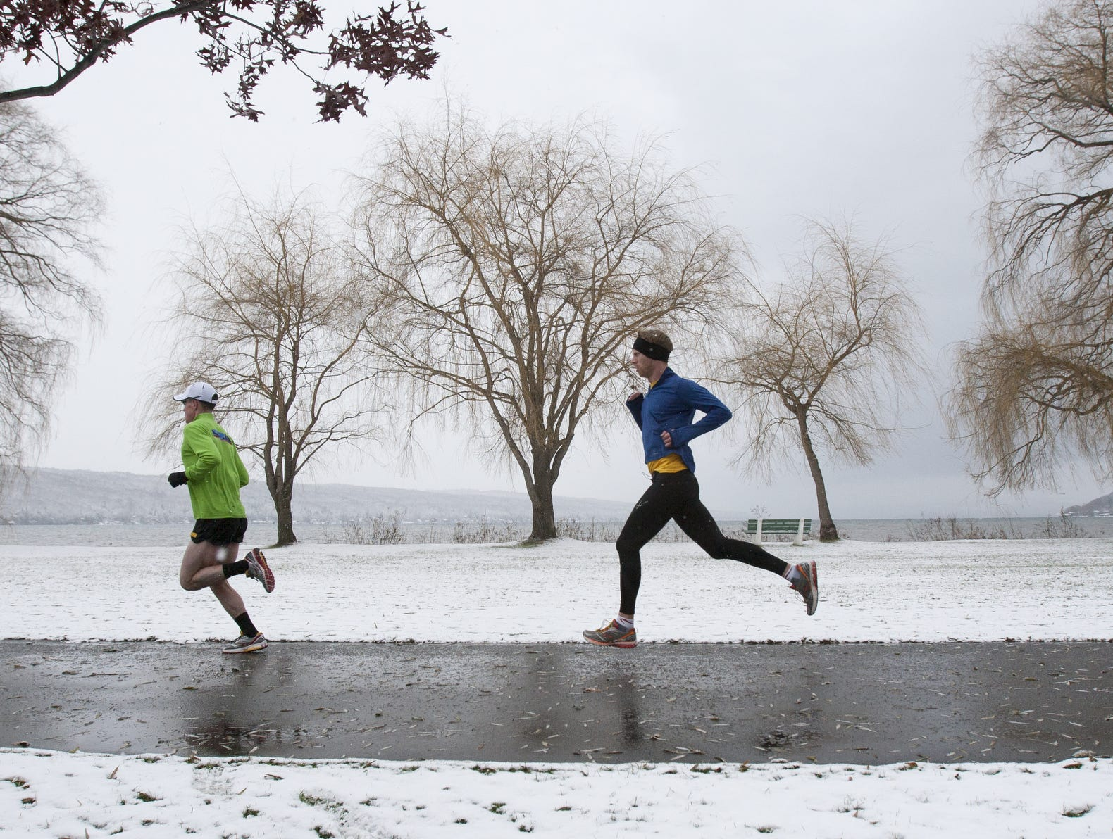 Runners pass the end of Cayuga Lake in Stewart Park during the 2014 Turkey Trot Prediction Run.