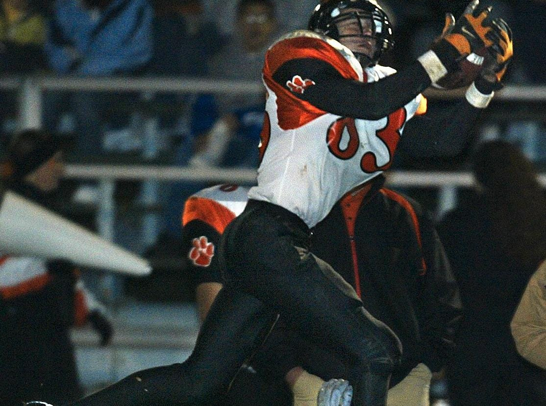 From 2003: Vestal #42, Kyle Cunningham falls as Union-Endicott #83, Greg Adams catches the football for a first down, in the first quarter, Friday night at Vestal High School.