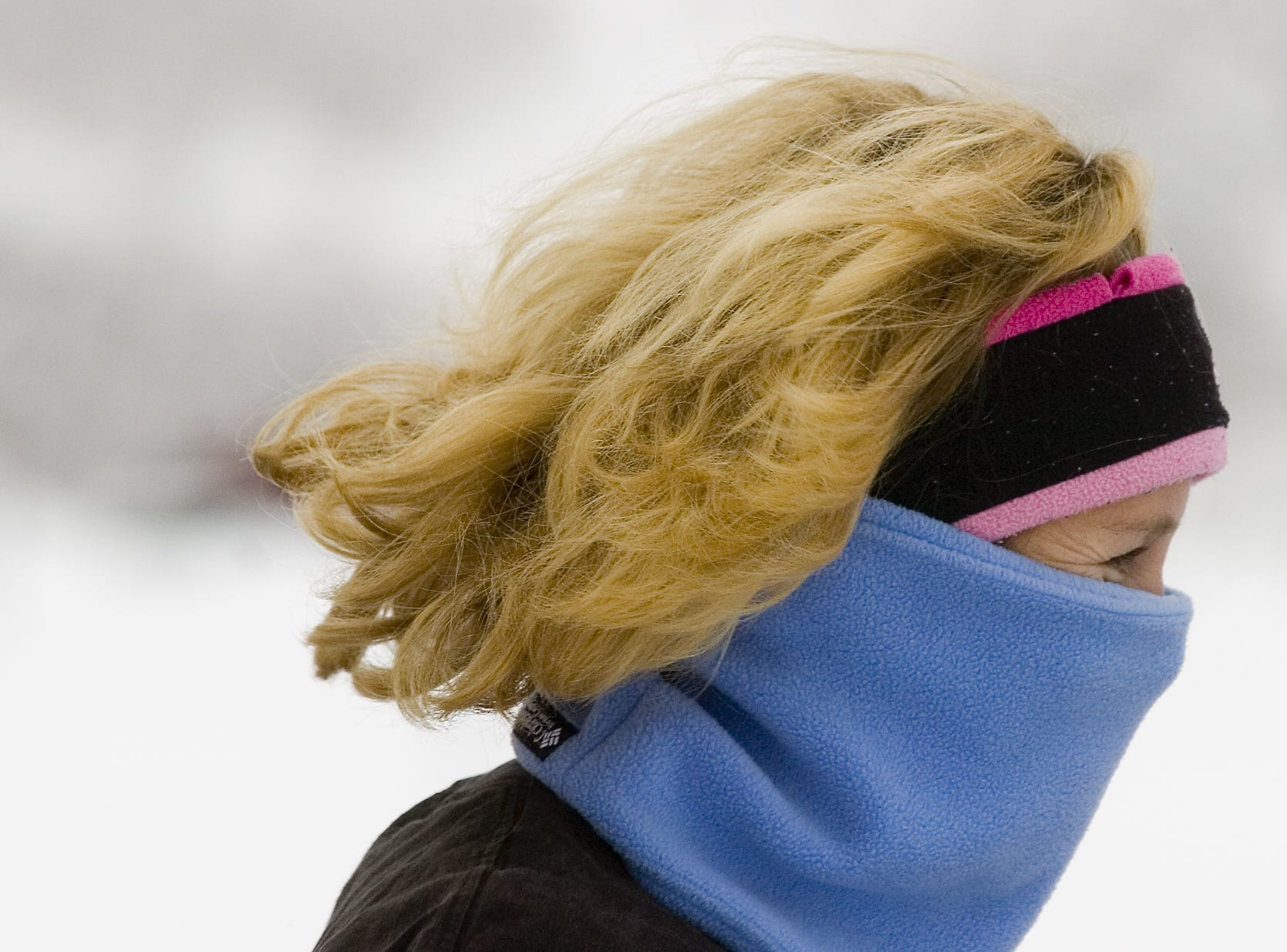 Gail Markstein of Colesville is protected from the cold as she  participates in the annual YMCA 5K Resolution Run in 2007, held on New Year's Eve at Otsiningo Park.