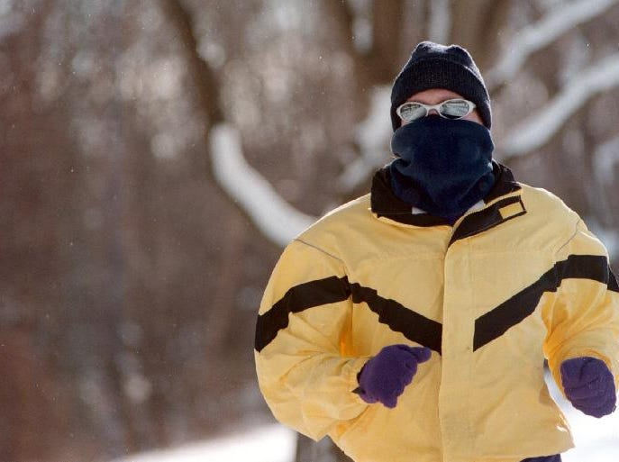 From 1998: Kevin Loveland warms up for the Broome Couty YMCA's Resolution Run. Despite the cold, approximately 100 runners came to Otsiningo Park for the annual event.