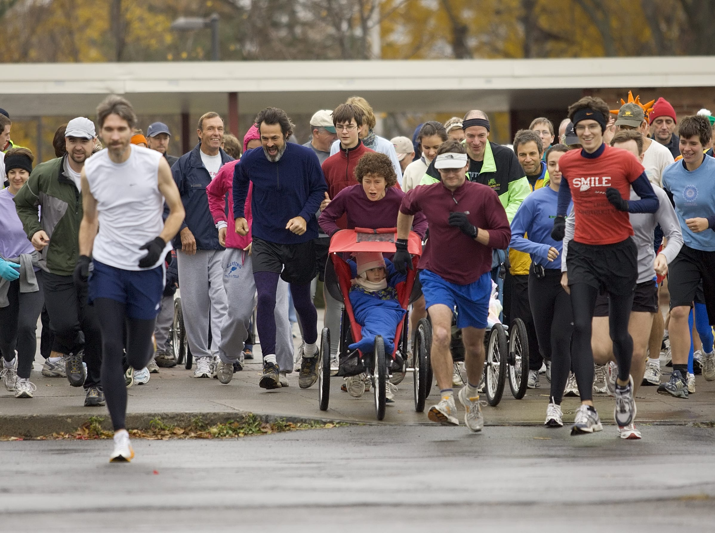 From 2007: The participants in the 35th Annual Bob's Prediction Turkey Trot leave Ithaca High school Thursday morning before running an approximately 5 mile course through Cayuga Heights, Stewart Park and Newman Golf Course. The object of the fun and social oriented event is to predict your time and those who finish closest to their prediction take home a pie.
