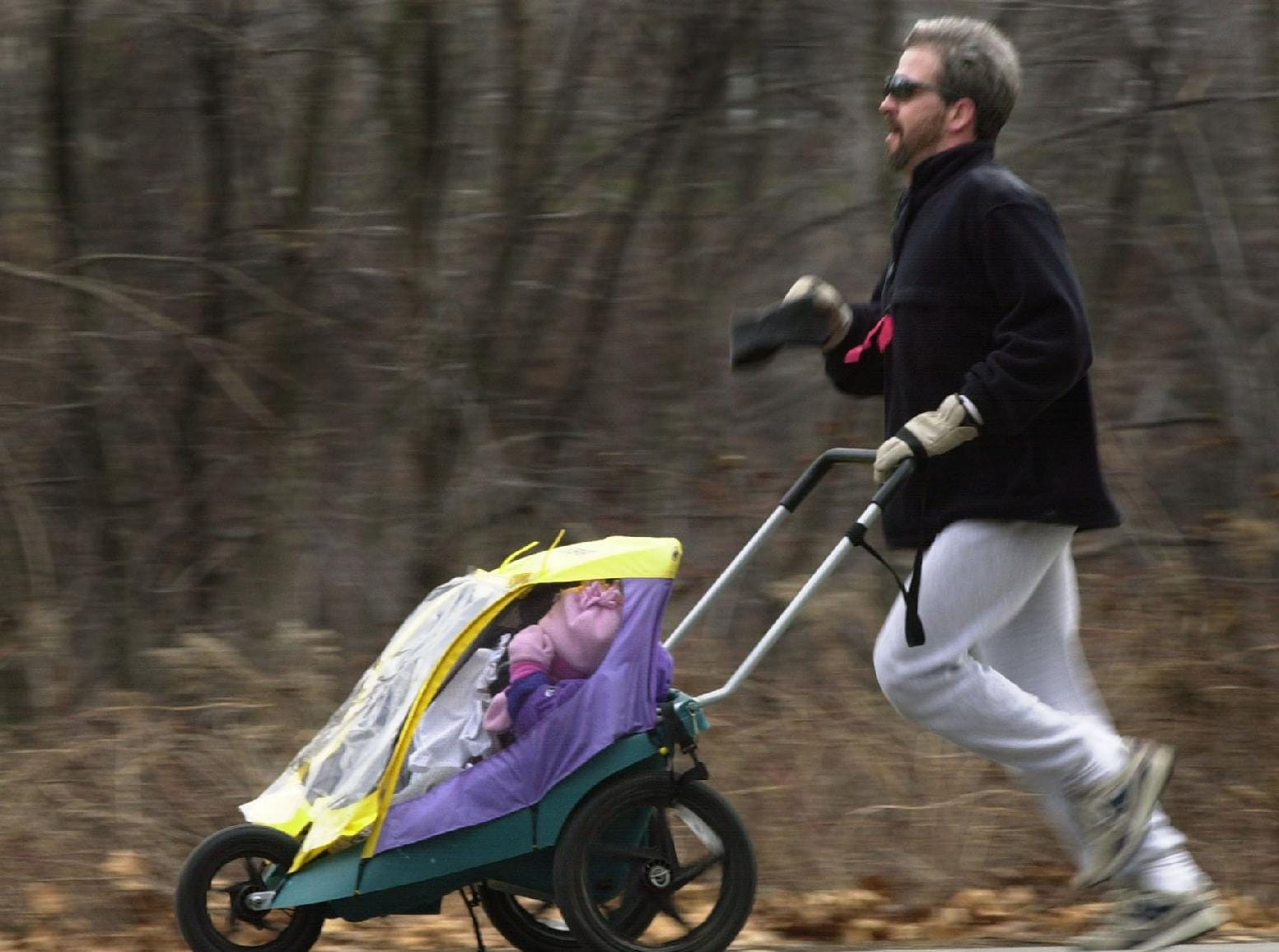 From 2001: Rick Pado of Apalachin runs along an Otsiningo Park pathway pushing a stroller with his children Richard, 5, and Alexandra, 3, inside during the annual YMCA Resolution Run.