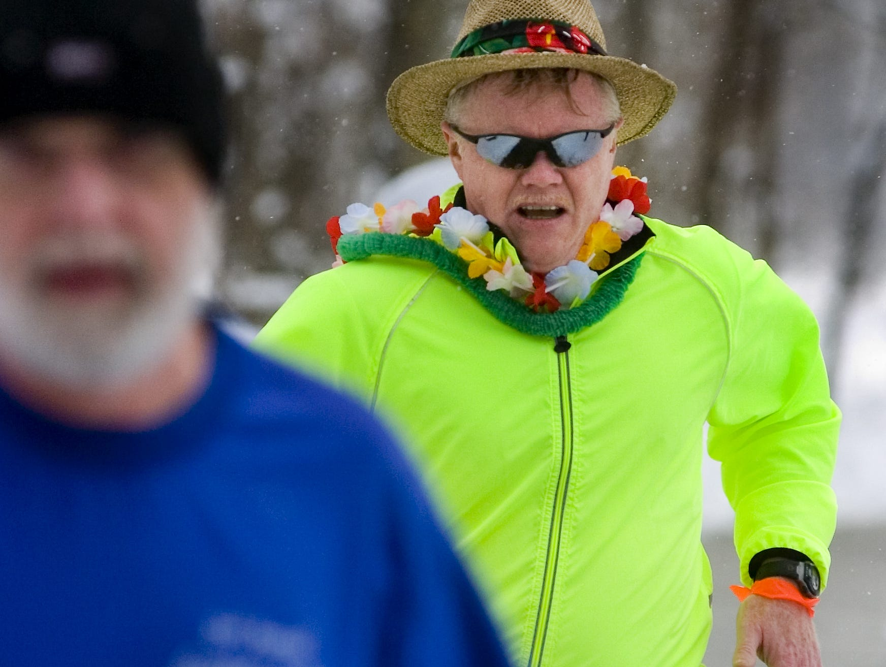 From 2007: Dan Bartschi of Vestal wears leis and a summer hat as he participates in the annual YMCA 5K Resolution Run, held on New Year's Eve at Otsiningo Park. He just returned from Florida and wanted to bring the warmth with him.