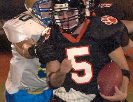 From 2001: Union-Endicott's Geoff Renfro is caught from behind by Maine-Endwell's Pasquale Iacono in the first quarter at Ty Cobb Stadium Saturday night.