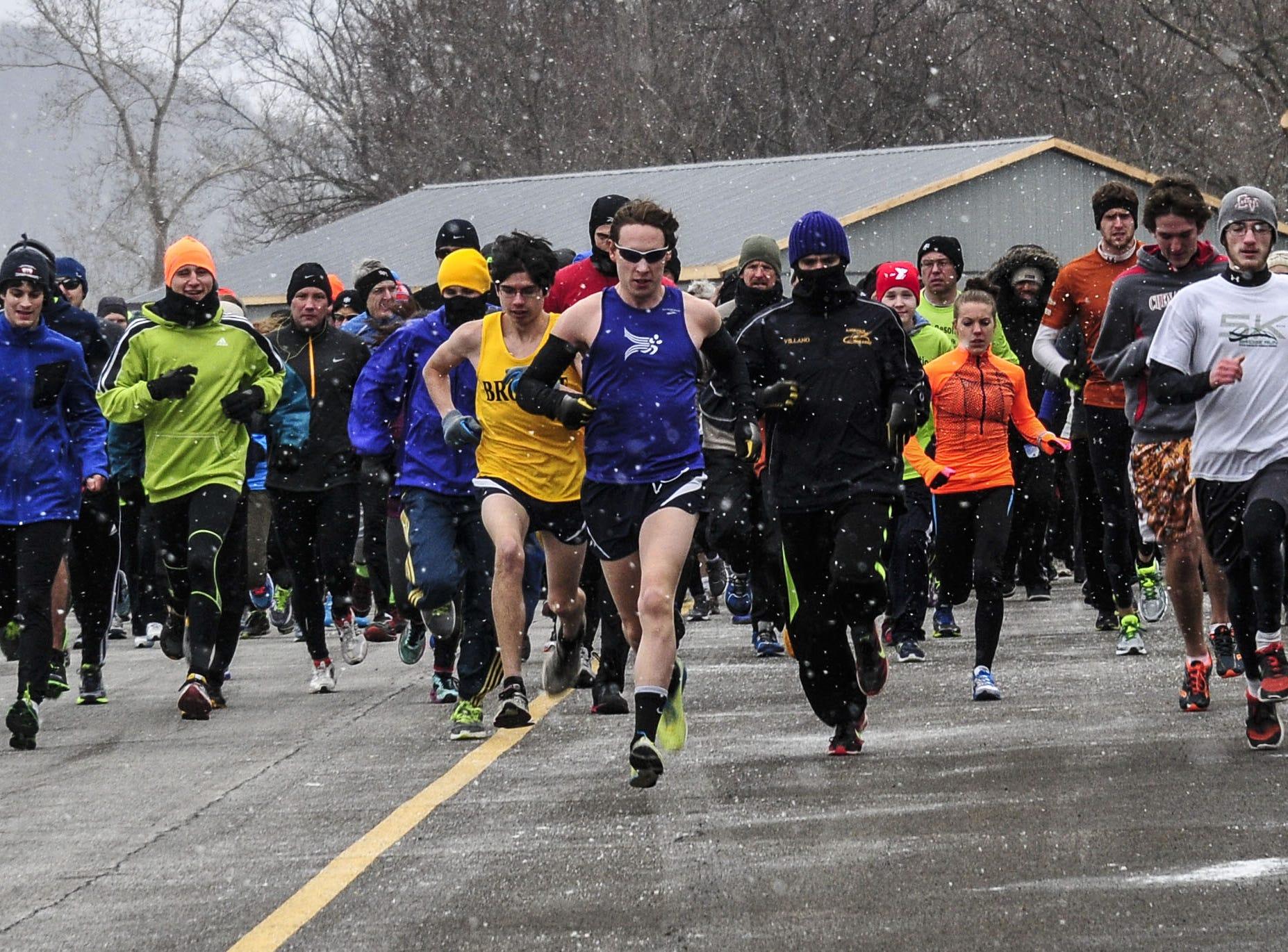 From 2013: Runners start the Family Resolution 5K Fun Run/Walk  Otsiningo Park.
