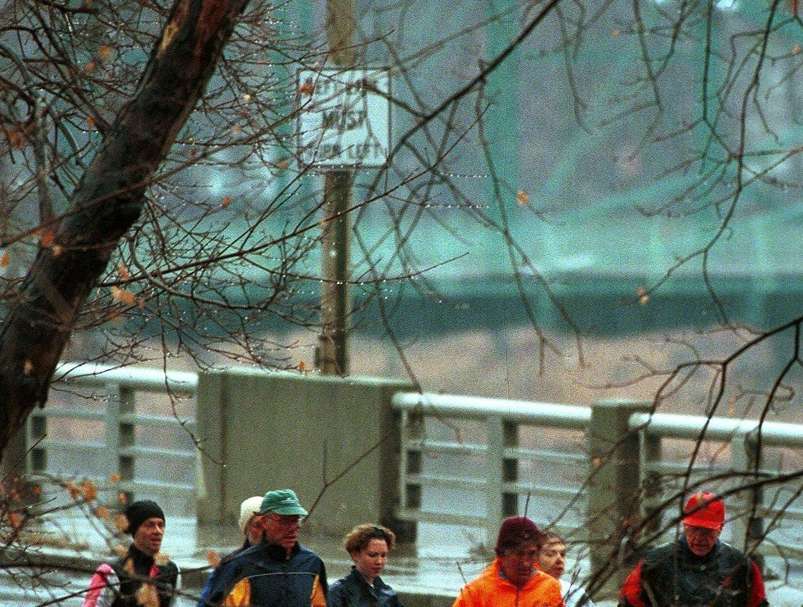 Runners make their way over the Riverside Drive bridge near the start of the YMCA Turkey Trot Thanksgiving morning in 1999.