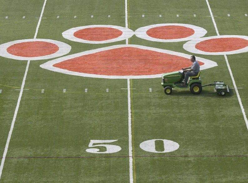 From 2004: George Kolmel, with Union-Endicott High School's Grounds Operations department, rakes the U-E High School football field on Wednesday. The Endicott school's field willl see a variety of Empire State Games events.