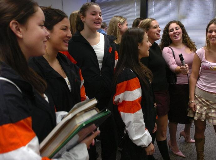 Union-Endicott High School cheerleaders gather in the office to cheer during morning announcements in 2004.