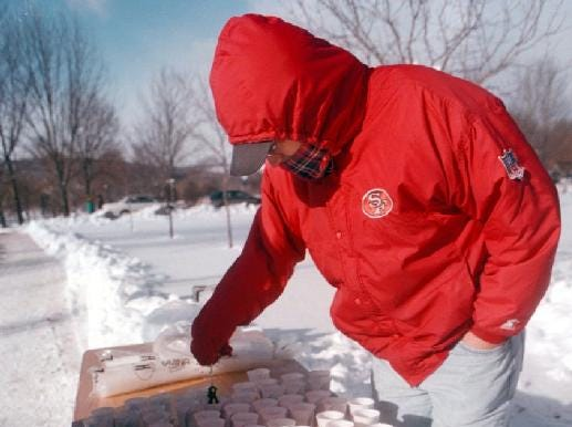 From 1998: Volunteer Al Ray breaks ice out of water cups left for runners at the Resolution Run.