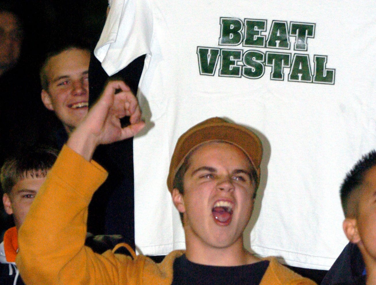 """From 2006: A shirt with the words """"BEAT VESTAL"""" printed on it is held up behind Union-Endicott supporter Nick Frazier, 16, as he cheers for the U-E football team during Friday's match atVestal."""