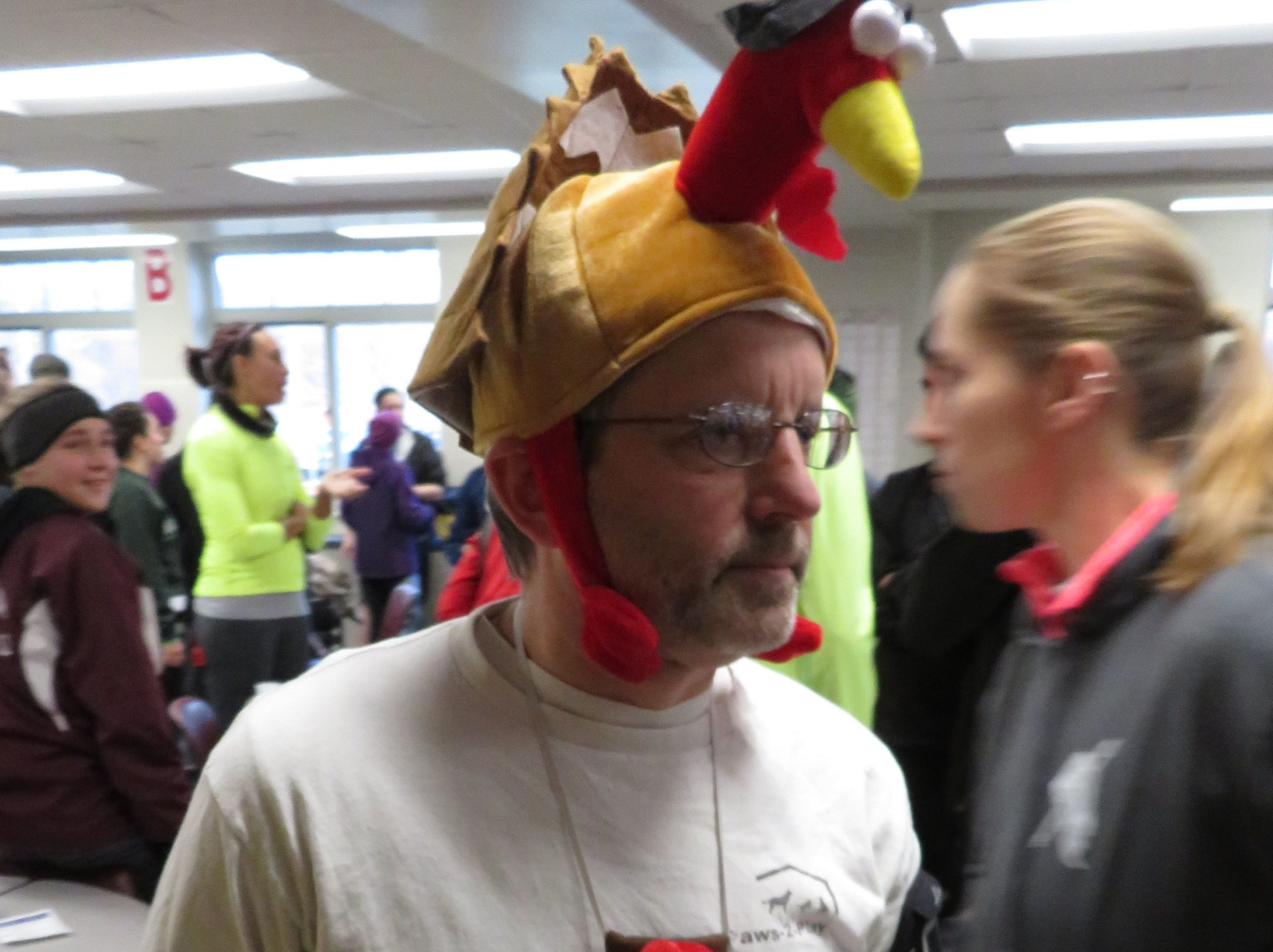 From 2017: Bill Liddick was decked out with three-dimensional turkey decorations as he ran the 45th annual Turkey Trot.