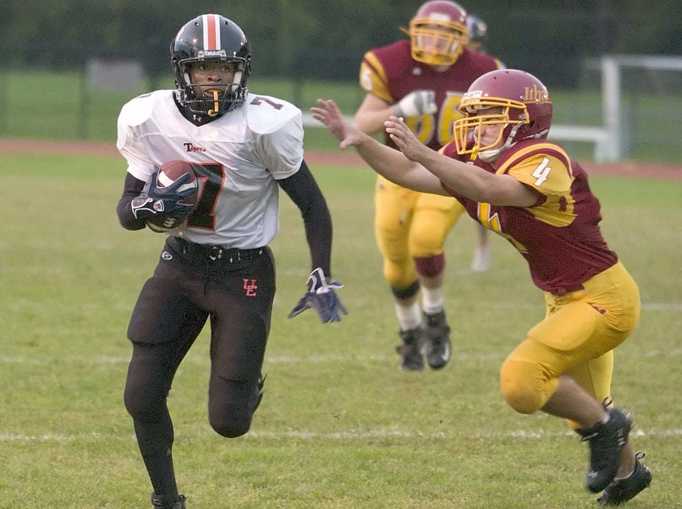 From 2006: Union Endicott's Jermaine Thomas, left, evades Ithaca High's Tim Sidle as he runs down field in the first quarter Friday in Ithaca.