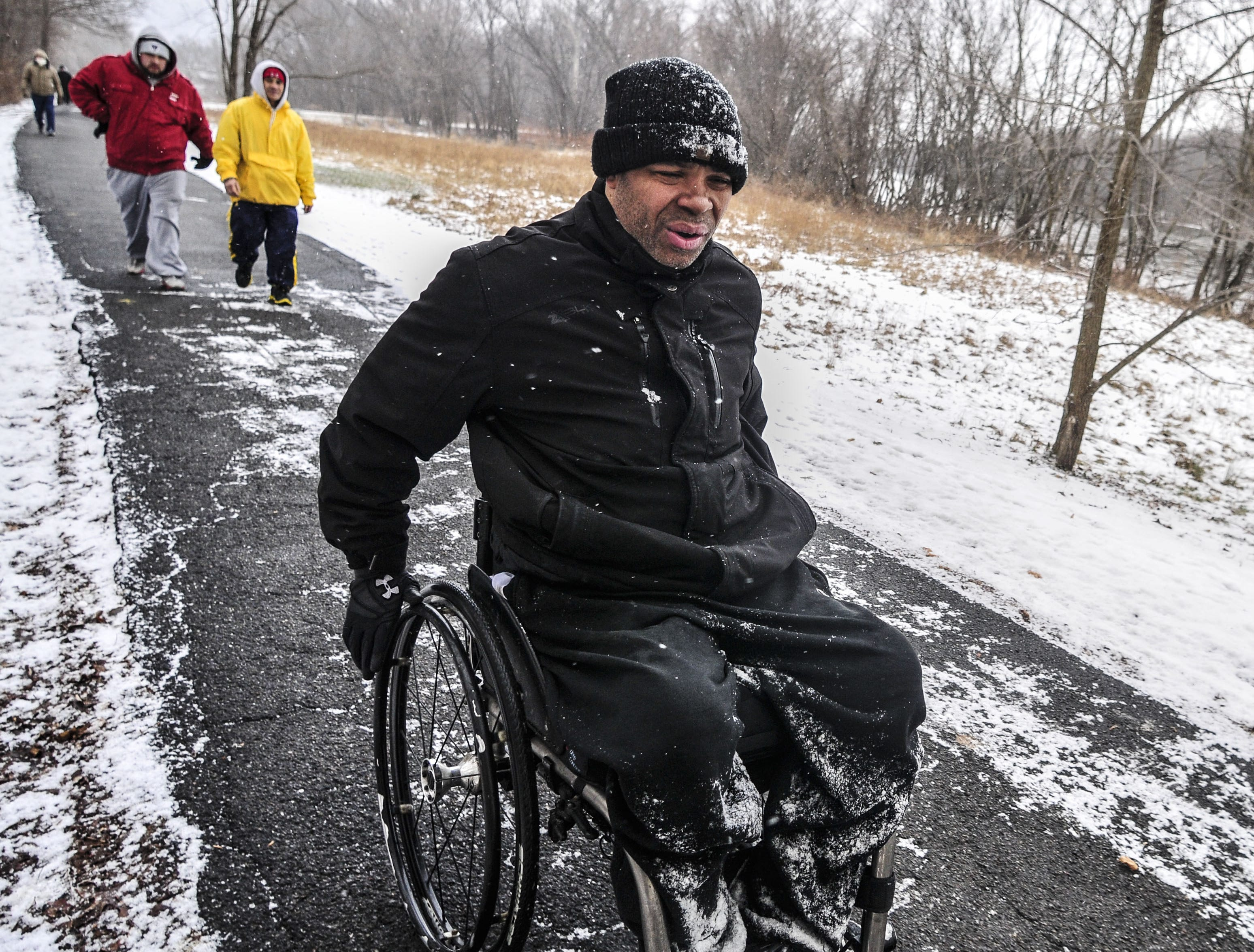 From 2013: Damon Rozier, from Brooklyn, participates in the Family Resolution 5K Fun Run/Walk hosted by the YMCA of Broome County on Tuesday at Otsiningo Park in the Town of Dickinson. Rozier, a quadriplegic, is participating in the 5K for the second time.