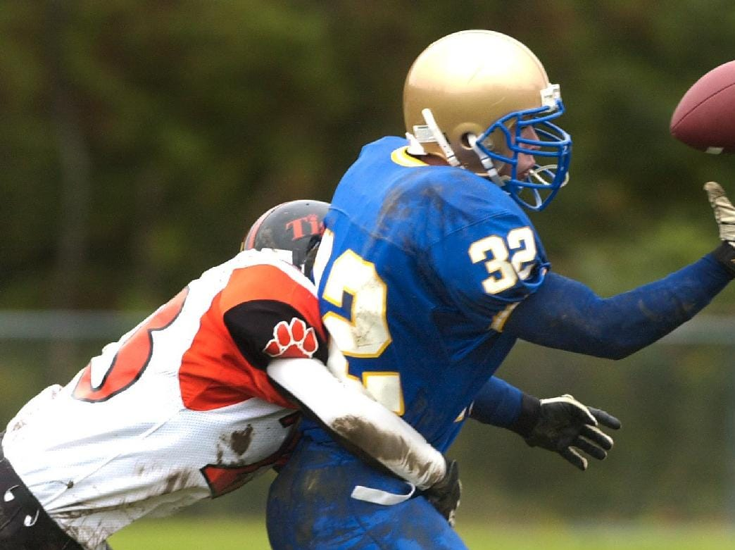 From 2003: Maine-Endwell's Mike Major keeps his concentration reaching out for the football as Union-Endicott's Geoff Renfro makes the tackle in the first period Saturday afternoon at Maine-Endwell High School.
