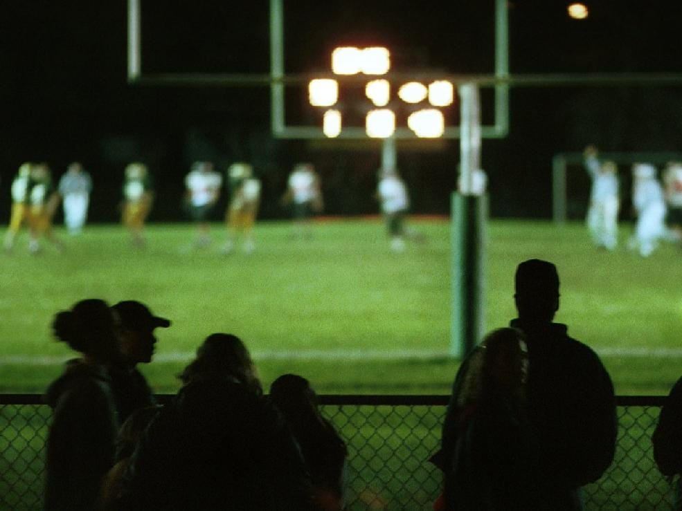 In 1999, football fans line the fence at Vestal's football field for the big showdown between Vestal and Union-Endicott.